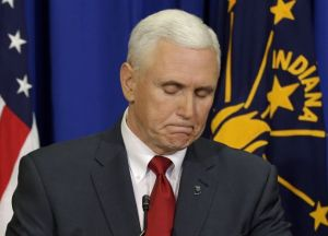 """Governor Pence looks down for several minutes to use his fingers as  a reporter asks him """"How many is two plus two""""."""